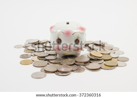 piggy bank Piggy isolated with a pile coins on the white background - stock photo
