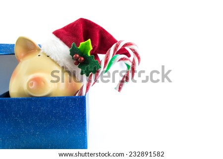 Piggy bank Santa in gift box isolated on white  - stock photo