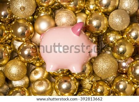 Piggy bank saving for Christmas studio - stock photo