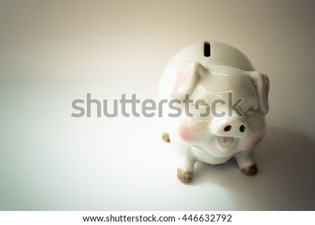 Piggy bank savings concept with vintage tone.
