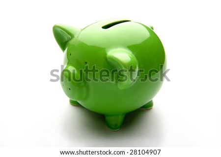 Piggy bank style money box isolated on a white studio background. - stock photo