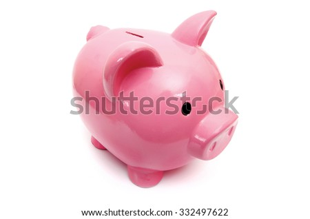 Piggy bank style money box isolated on a white studio background - stock photo