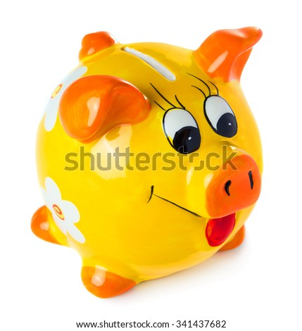 Piggy bank style money box isolated on a white studio background. - stock photo