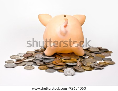 piggy bank turned his back to the viewer on a light background