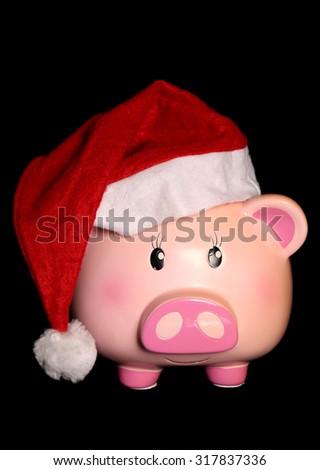 Piggy bank wearing a santa hat cutout - stock photo