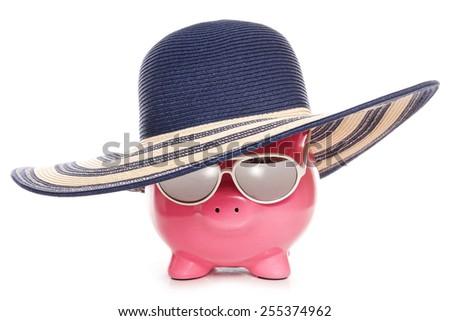 piggy bank wearing a summer hat cutout - stock photo
