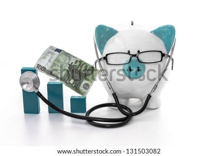 Piggy bank wearing glasses and stethoscope listening to blue graph model - stock photo