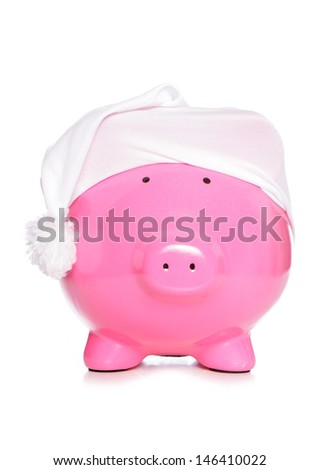 Piggy bank wearing sleeping cap studio cutout - stock photo