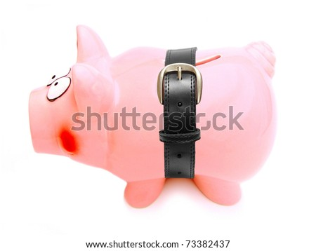 Piggy bank with a belt wrapped around its shrinking body - stock photo