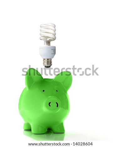 Piggy bank with a CF bulb above (smart energy) - stock photo