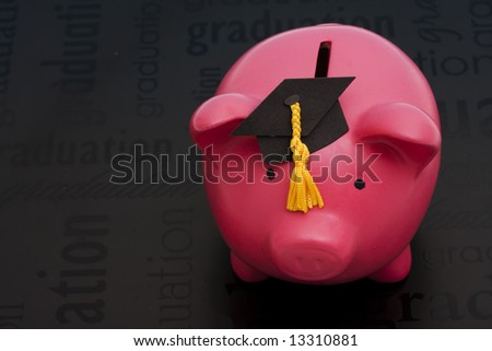 Piggy bank with a graduation cap – cost of education - stock photo