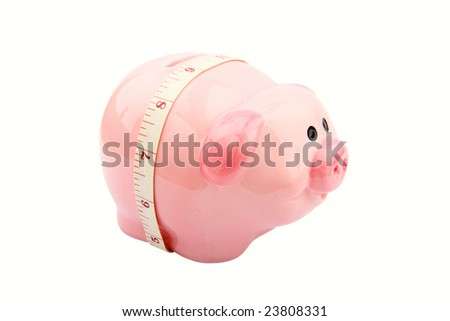 Piggy bank with a tape measure showing the concept of slimming down resources - stock photo
