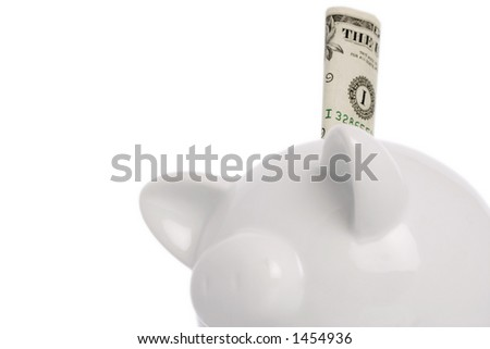 piggy bank with american dollar note in slot - stock photo