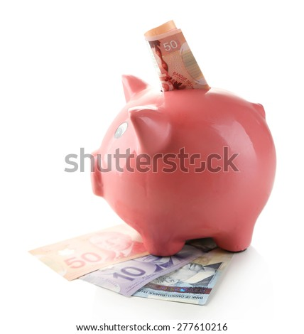 Piggy bank with Canadian dollars, isolated on white