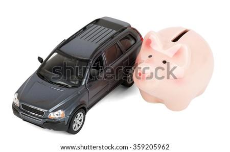 Piggy bank with car - stock photo