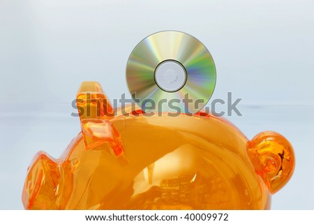 Piggy bank with CD - stock photo