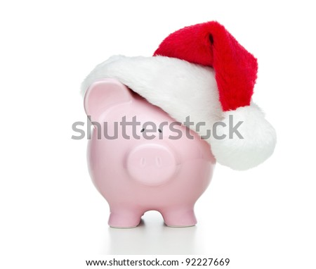 Piggy bank with christmas hat isolated on white background - stock photo