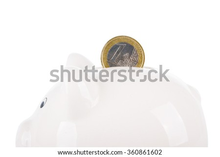 Piggy bank with coin isolated on white background - stock photo