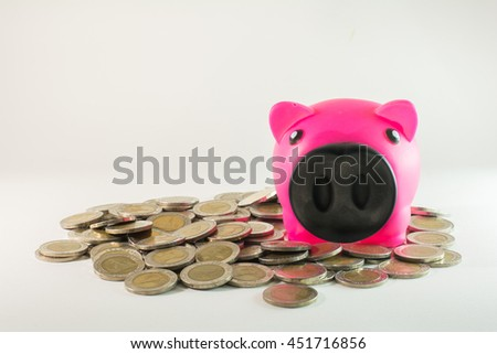 Piggy bank with coin  on white background,copy space.,Concept savingfor future. - stock photo