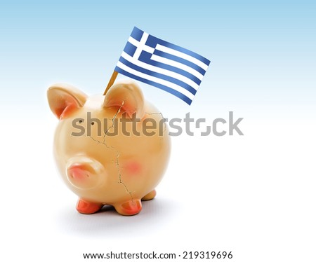 Piggy bank with cracks and national flag of Greece - stock photo