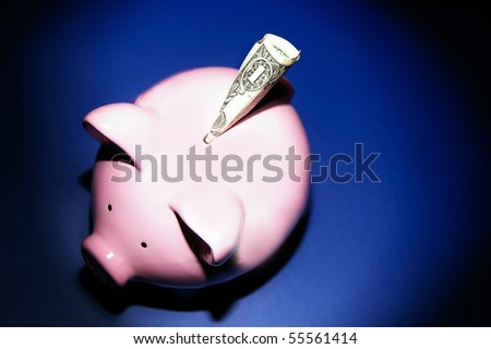 piggy bank with dollar bill - stock photo