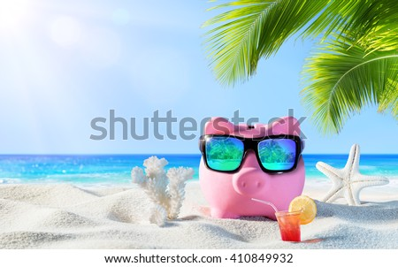 Piggy Bank With Drink On The Palm Beach - Holidays In Economic  - stock photo
