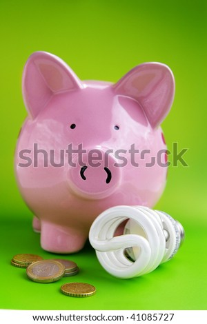piggy bank with efficient light bulb and Euro coins - stock photo