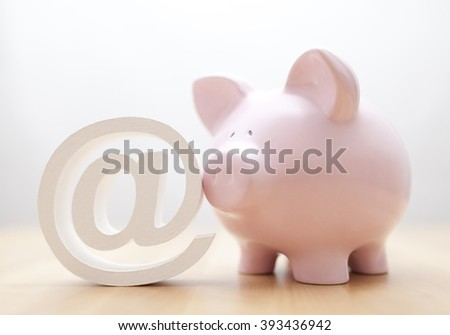 Piggy bank with email symbol  - stock photo