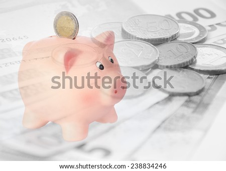 piggy bank with euro background - stock photo