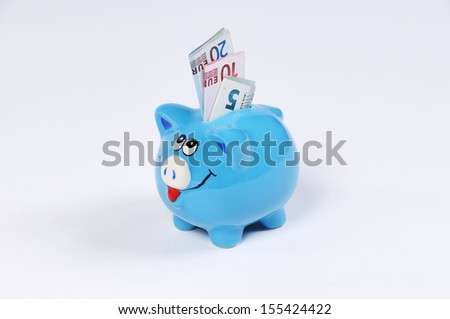 Piggy bank with Euro bills - stock photo