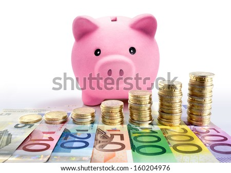 Piggy bank with euro coin stacks and banknotes - increase - stock photo
