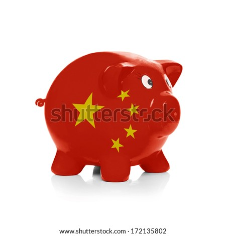 Piggy bank with flag coating over it isolated on white - China - stock photo