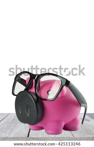 Piggy bank with glasses on isolated white