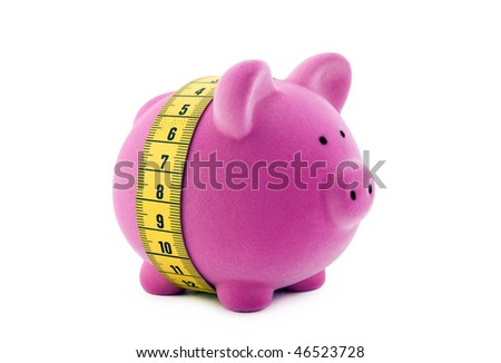 Piggy bank with measure tape. Clipping path included. - stock photo