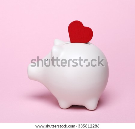 Piggy bank with red heart shape