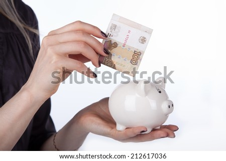 piggy bank with Russian banknotes on white - stock photo
