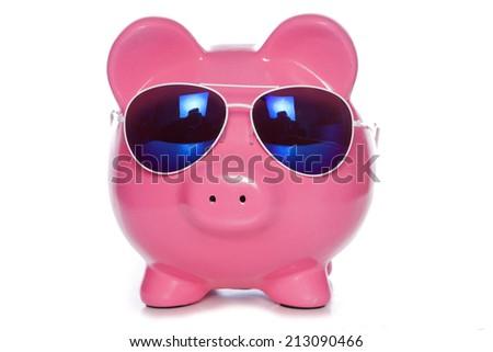 piggy bank with sunglasses studio cutout - stock photo