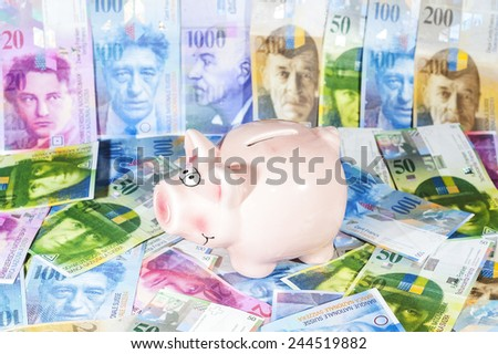 Piggy bank with  Swiss francs  - stock photo