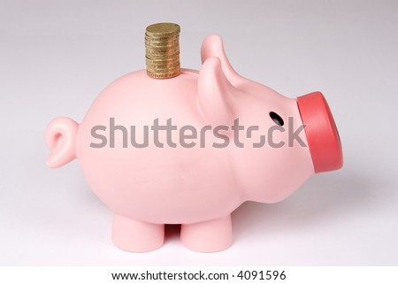 Piggy bank with tower of coins