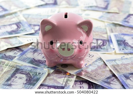 Piggy bank with twenty pound currency notes