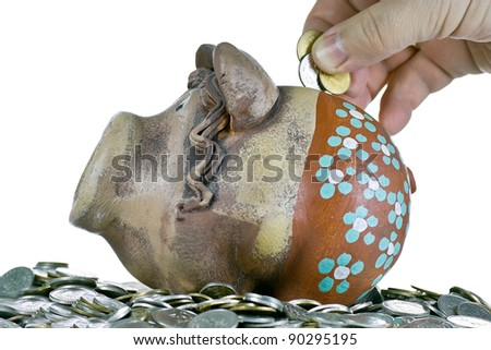 Piggy banks and coins on a white background. - stock photo