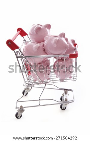 Piggy Banks in trolley on White Background - stock photo