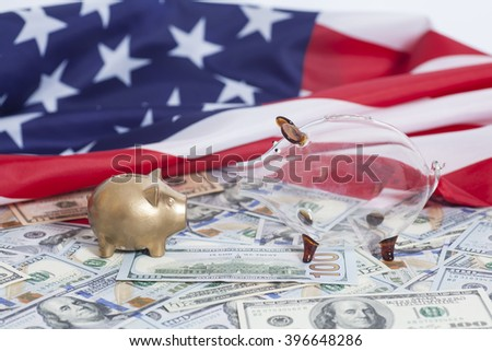 Piggy Banks on Dollars with American Flag - stock photo