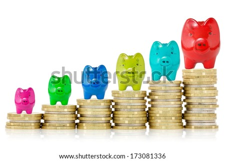 Piggy banks on top of stack of coins showing growth  - stock photo