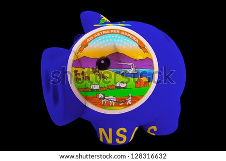 piggy rich bank in colors flag of us state of kansas for saving money on black background