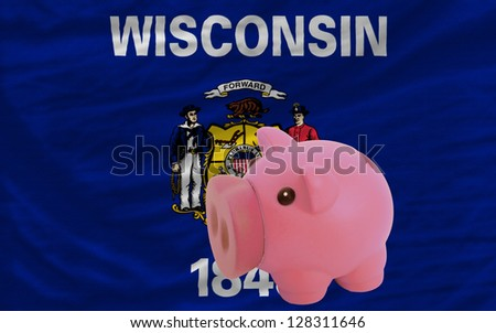 Piggy rich bank in front of flag of us state of wisconsin symbolizing saving and accumulating funds as good financial habit - stock photo