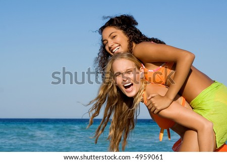 piggyback at beach - stock photo
