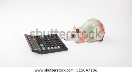Piggybank and calculator - stock photo
