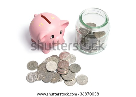 Piggybank and Coins in Glass Jar on White Background