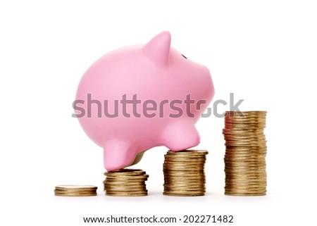 Piggybank and money tower - stock photo